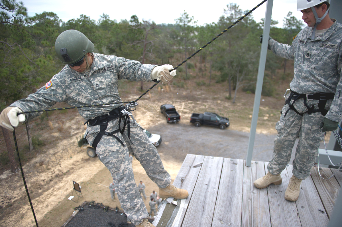 A member of the 7th Special Forces Group prepares to rappel down a tower during an unrelated training exercise.