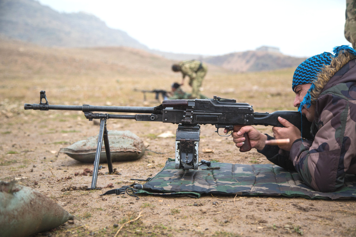 A member of Iraq's security forces fires a PK-style machine gun during training overseen by members of the US-led coalition.