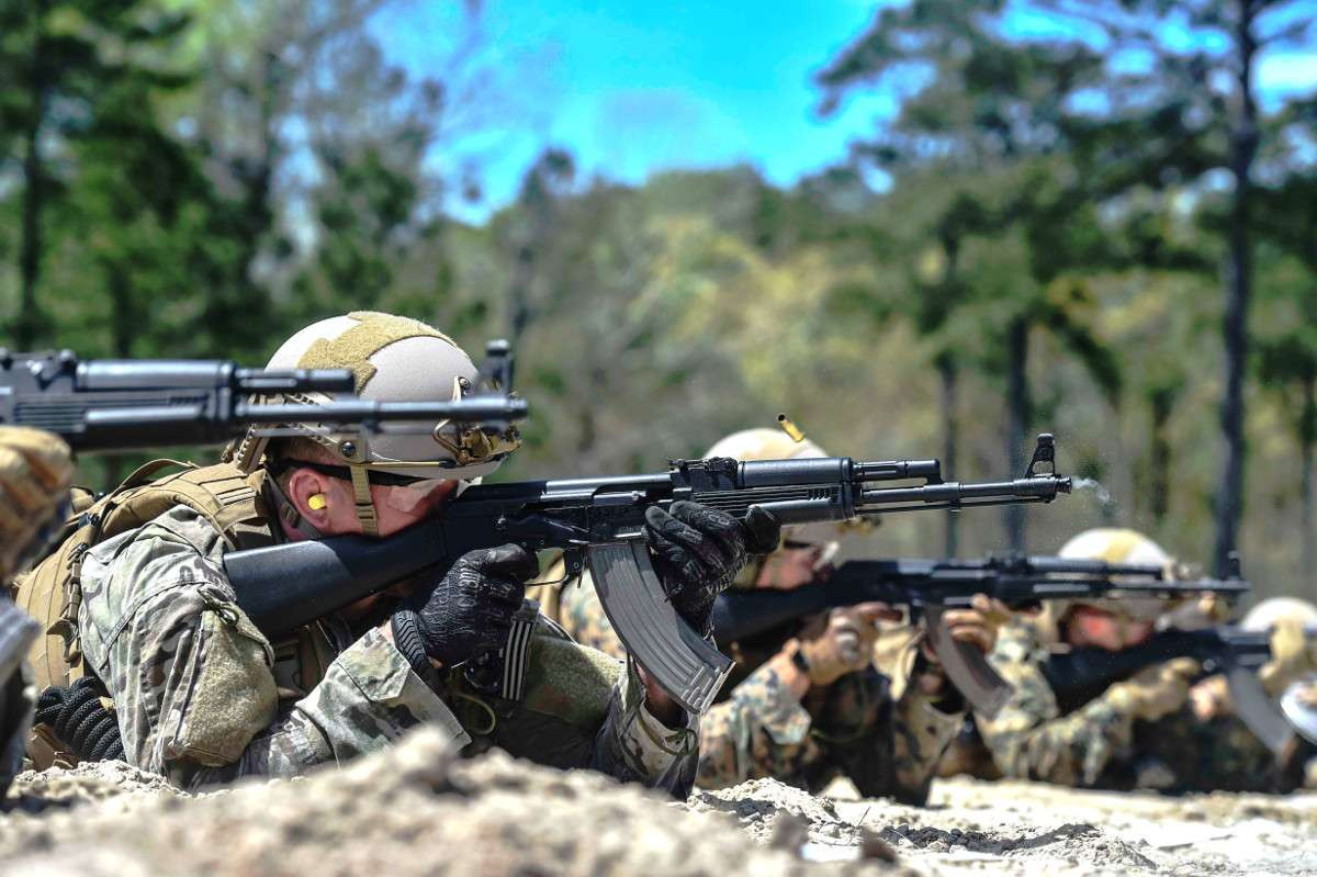 Members of Marine Corps Forces Special Operations Command shoot Kalashnikov AKM-style rifles during a training exercise.