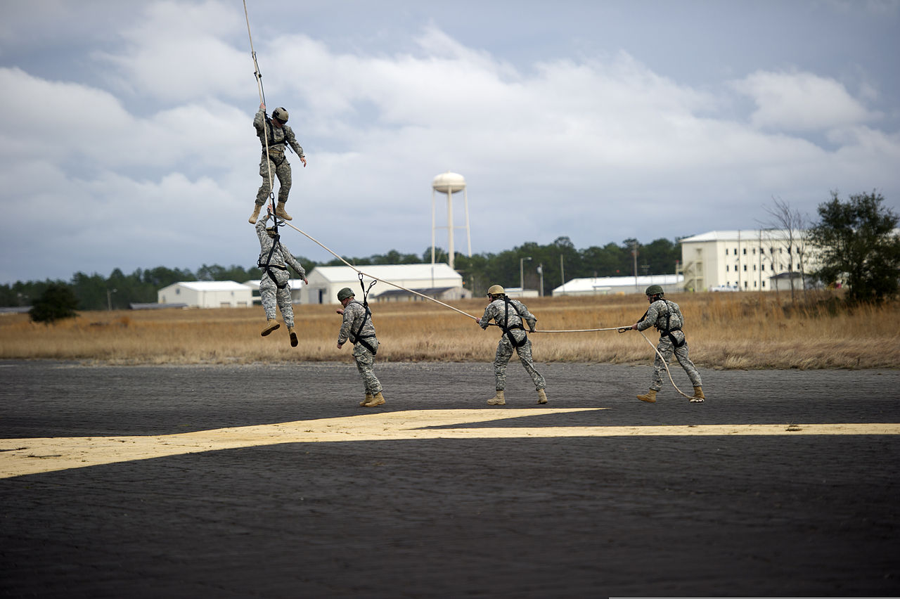 U.S. Soldiers with the 7th Special Forces Group (Airborne) are lifted off the ground by a CH-47 Chinook helicopter during Special Purpose Insertion Extraction (SPIE) training event at Eglin Base Air Force Base.