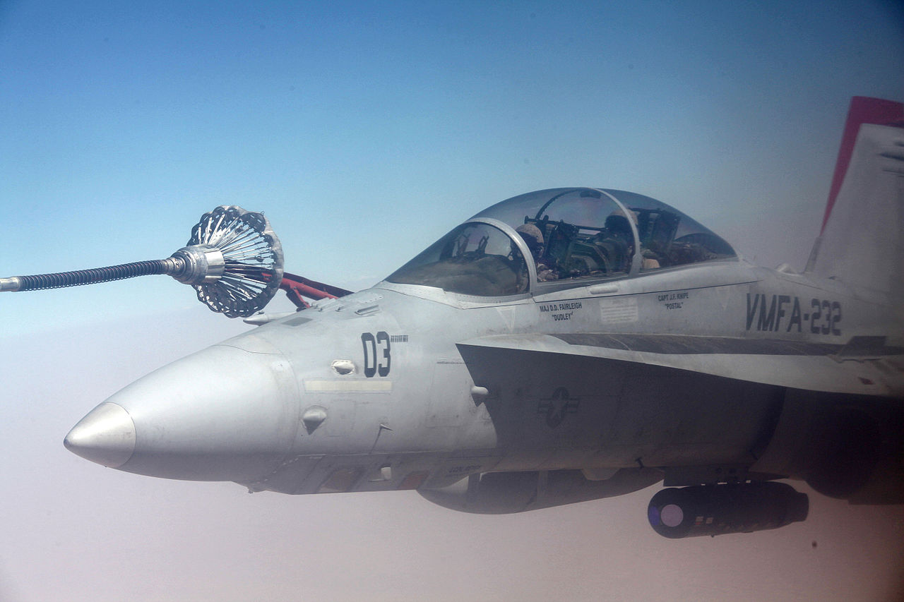 USMC ATARS equipped F/A-18D refueling from a KC-130.