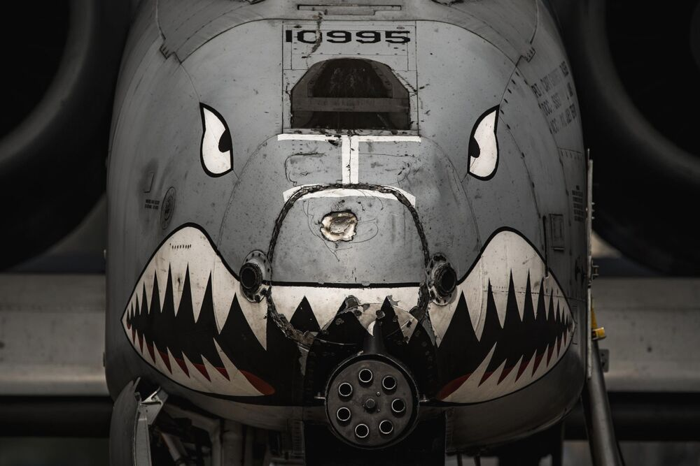 The nose of an A-10 Warthog with a very visible dent in its nose from a tanker's boom.