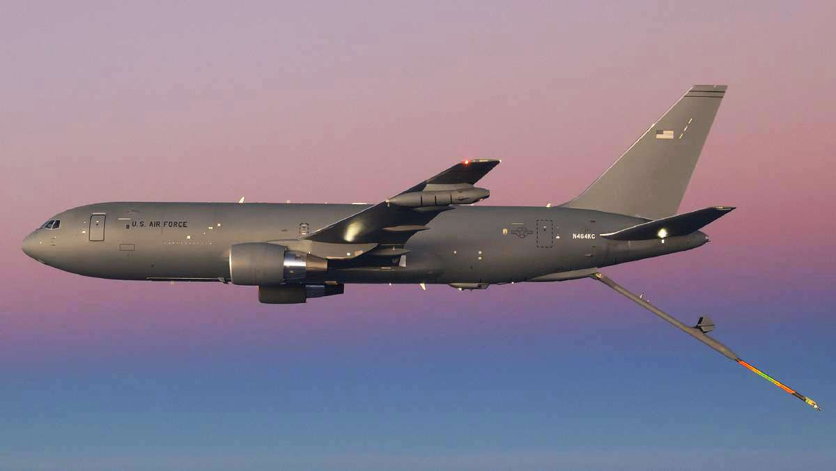 A KC-46A with its boom fully extended.