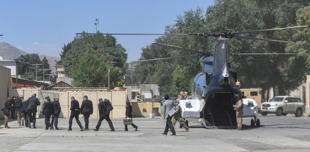 Secretary of State Mike Pompeo and his staff exit a contractor-operated helicopter at the U.S. Embassy in Kabul, Afghanistan after making the brief trip from Hamid Karzai International Airport during a visit in July 2018.