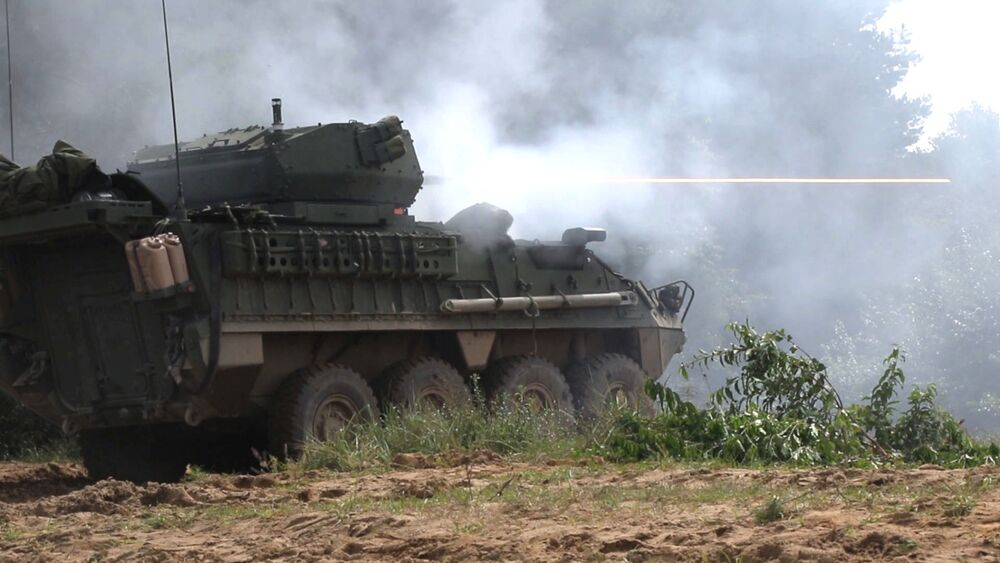 A Stryker Dragoon fires its main gun during an exercise.