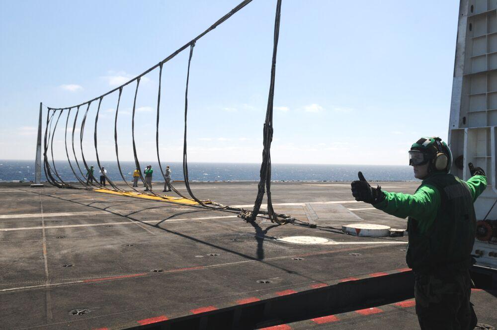 The barricade system in place on the <em>Nimitz</em>-class carrier USS <em>Ronald Reagan</em>.