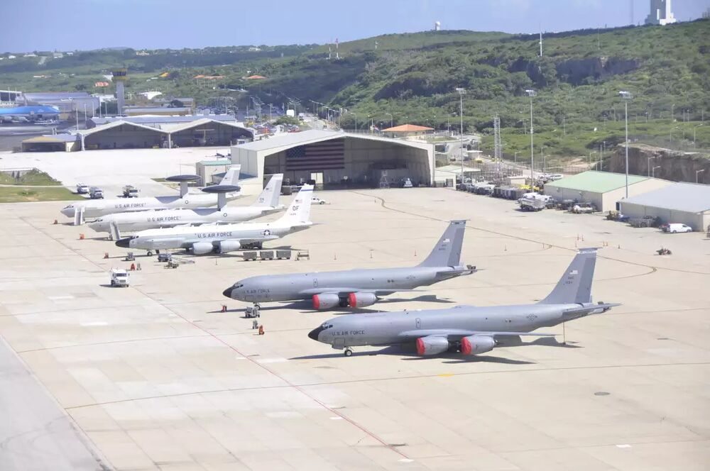 Front to back, two US Air Force E-3 Sentry Airborne Warning and Control System (AWACS) radar planes, an RC-135V/W Rivet Joint, and two KC-135R Tankers at the US forward operating location on the Dutch island of Curaçao.