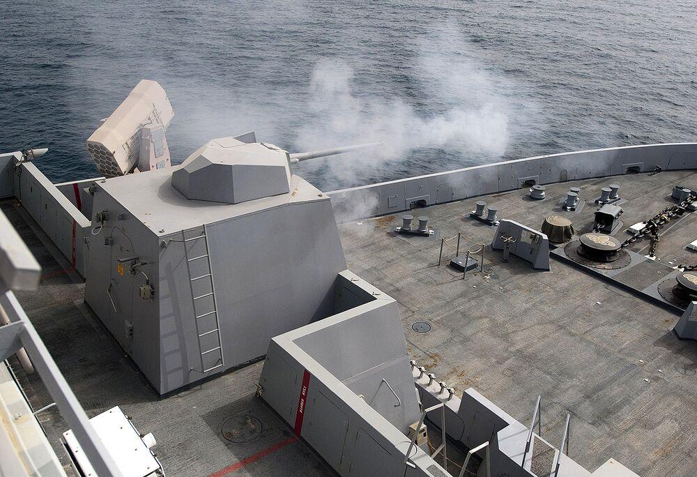 Mk46 cannon being fired aboard a <em>San Antonio</em> class ship.