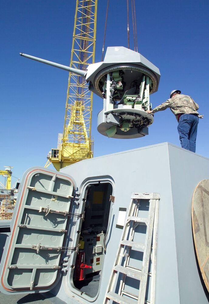 Installing the MK46 Bushmaster 30mm gun system aboard a San Antonio class amphib.