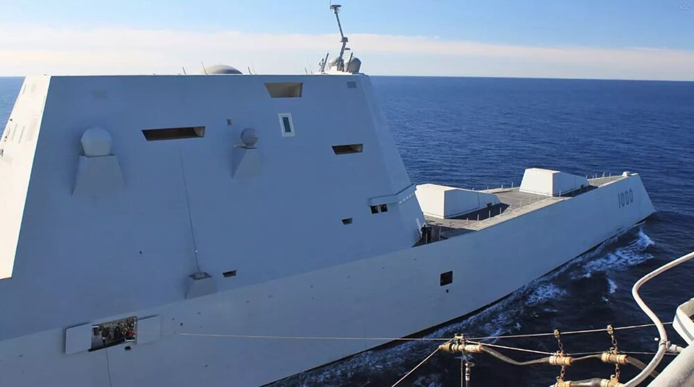 Zumwalt replenishing while underway. You can see all the bolt on systems that have been added. These have compromised the original stealthy vision for the ship to some degree.