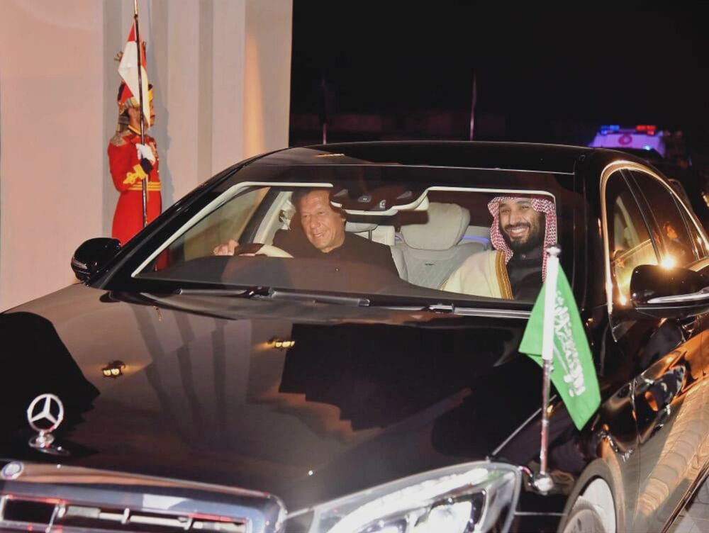 Pakistani Prime Minister Imran Khan, at left, personally drives Saudi Arabia's Crown Prince Mohammed bin Salman to his accommodations after the Saudi royal arrived for his state visit on Feb. 17, 2019.