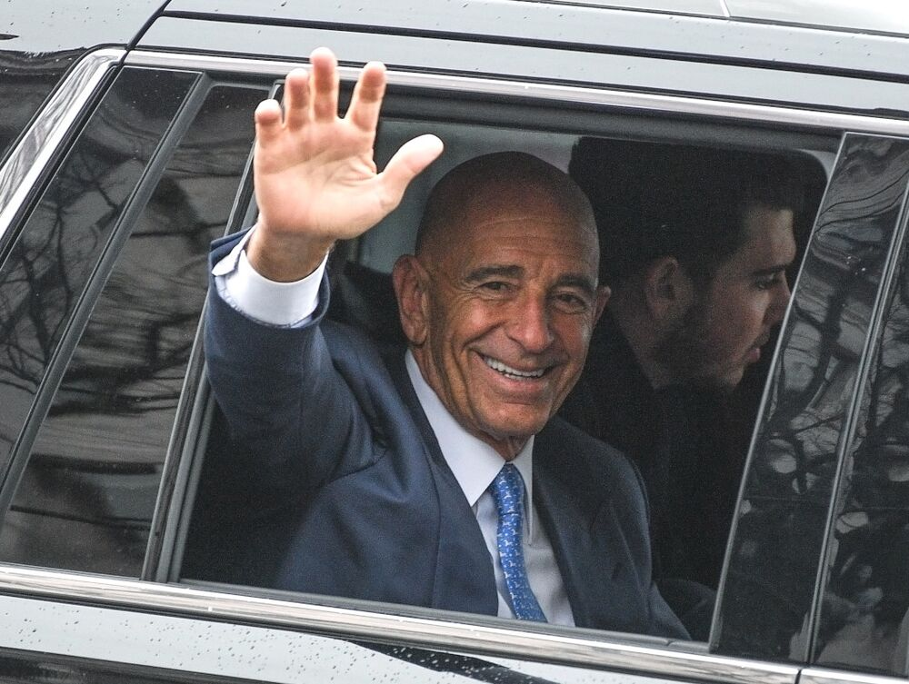Thomas Barrack waves from a car during President Trump's inauguration day parade in January 2017.