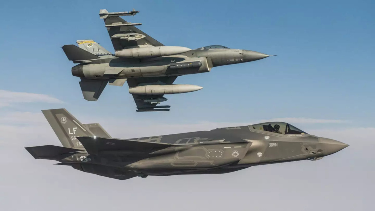 An F-16C and an F-35A fly together.